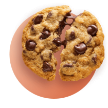 A chocolate chip cookie broken in half with melty chocolate pulling against an orange gradient circle.