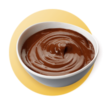 A white bowl of chocolate pudding against a yellow gradient circle.