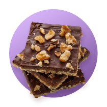Three pieces of saltine toffee bark topped with nuts and chocolate against a purple gradient circle.