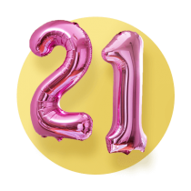 Two shiny pink mylar balloons for a 21st birthday. One 2 balloon and one 1 balloon in front of a yellow gradient circle.