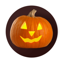A classic jack-o-lantern carved with simple triangle eyes, nose, and toothy grin against a dark brown gradient circle.