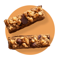 Two fudgy chocolate bars topped with semi-sweet and butterscotch morsel against an orange gradient circle.