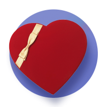 A red heart shaped chocolate box with a white ribbon against a royal blue gradient circle.