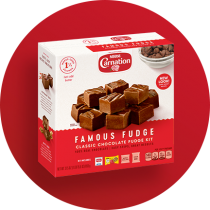 red circle. The kit shows the Carnation logo above a red plate stacked with fudge squares and a dark red label featuring the product name on a pink striped box.
