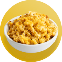 A white bowl of creamy mac and cheese topped with crunchy golden brown breadcrumbs in front of a yellow circle.