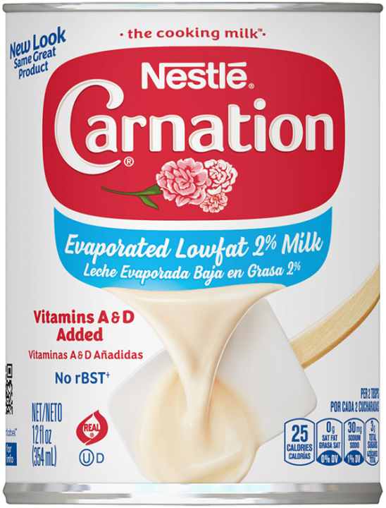 Front view photograph of a can of Evaporated Lowfat 2% Milk in the colors of white, red, and blue. It has the Carnation name and flower logo on it, a dark blue plastic bottle cap, and an image of evaporated milk pouring onto a white spatula.