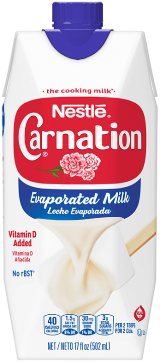 Front view photograph of a can of Evaporated Milk in the colors of white, red, and blue. It has the Carnation name and flower logo on it, a dark blue plastic bottle cap, and an image of evaporated milk pouring onto a white spatula.