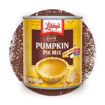 Front view photograph of an orange and brown can of Libby's Easy Pumpkin Pie Mix on a distressed brown circle . It has the Libby's name and red and white logo above a brown box displaying the product name in white and a whole pumpkin pie beside a gold serving spatula.