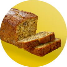 A loaf of banana bread with two slices cut in front of a yellow circle.