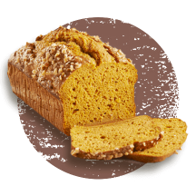 A loaf of pumpkin bread with 2 slices cut in front of a brown distressed circle.