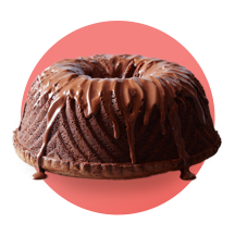 A chocolate Bundt cake covered in melted chocolate against a salmon colored gradient circle.