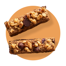 Two fudgy chocolate bars topped with semi-sweet and butterscotch morsels against an orange gradient circle.