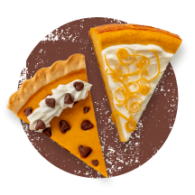 Triangle slices of chocolate chip pumpkin pie and orange cheesecake pumpkin pie on a distressed brown circle.