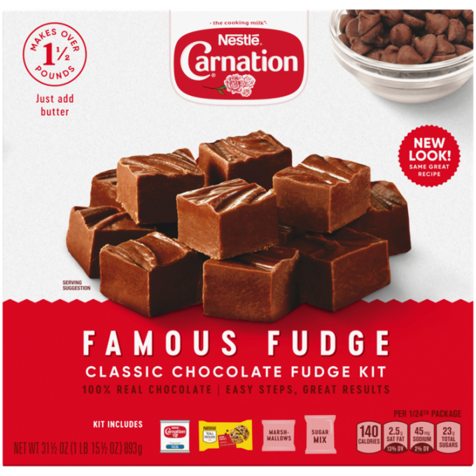 Front view of photograph of a box of Famous Fudge baking kit with the Carnation name and flower logo above a red plate stacked with fudge squares and a dark red label featuring the product name all on a pink striped box.
