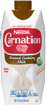 Front view of photograph of an octagonal carton of Lactose-Free Sweetened Condensed Milk in the colors of white and red. It has the Carnation name and flower logo on it, a brown plastic bottle cap, and an image of evaporated milk pouring onto a white spatula.